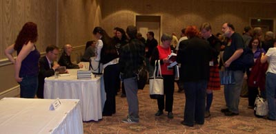 One more photo of people getting books signed at World Fantasy 2009