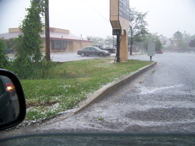 Rain with hail -- the white stuff on the edge of road.