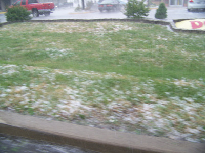 Hail stones on the side of the road.